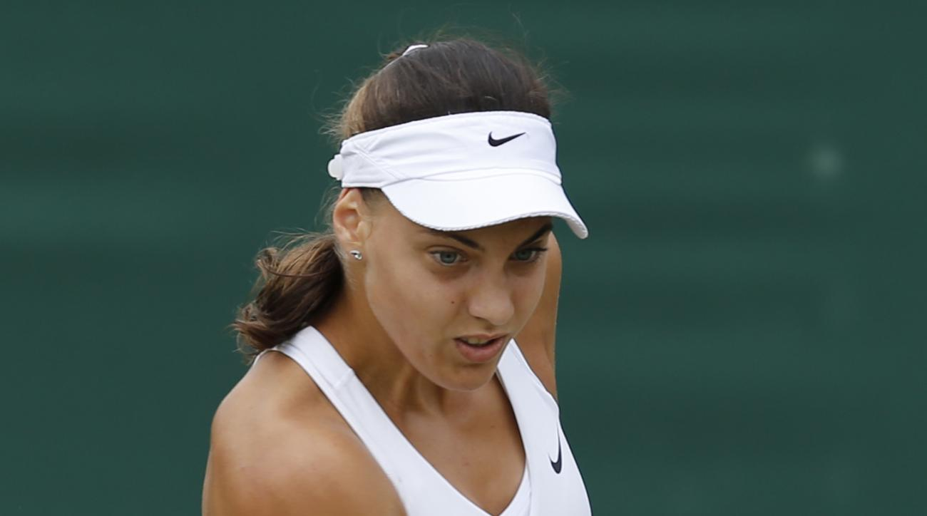 Ana Konjuh of Croatia plays a return to Caroline Wozniacki of Denmark during their women's singles match at the All England Lawn Tennis Championships in Wimbledon, London, Friday, June 27, 2014. (AP Photo/Ben Curtis)