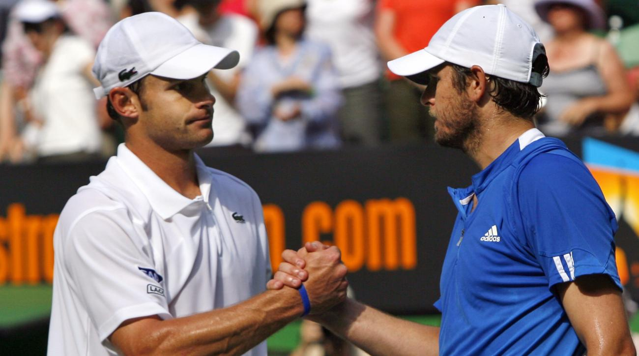 FILE- In this Jan. 23, 2007, file photo, Andy Roddick, left, of the United States, is congratulated by compatriot Mardy Fish after their quarterfinal match at the Australian Open tennis tournament in Melbourne, Australia. The pair will play doubles togeth