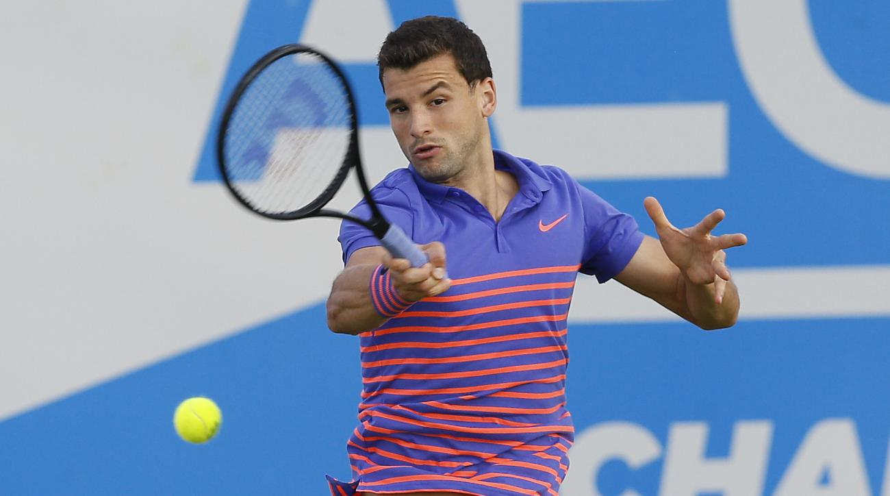 Grigor Dimitrov of Bulgaria plays a return to Sam Querrey of the US  during their singles tennis match at the Aegon Championships in London, Monday, June 15, 2015. (AP Photo/Kirsty Wigglesworth)