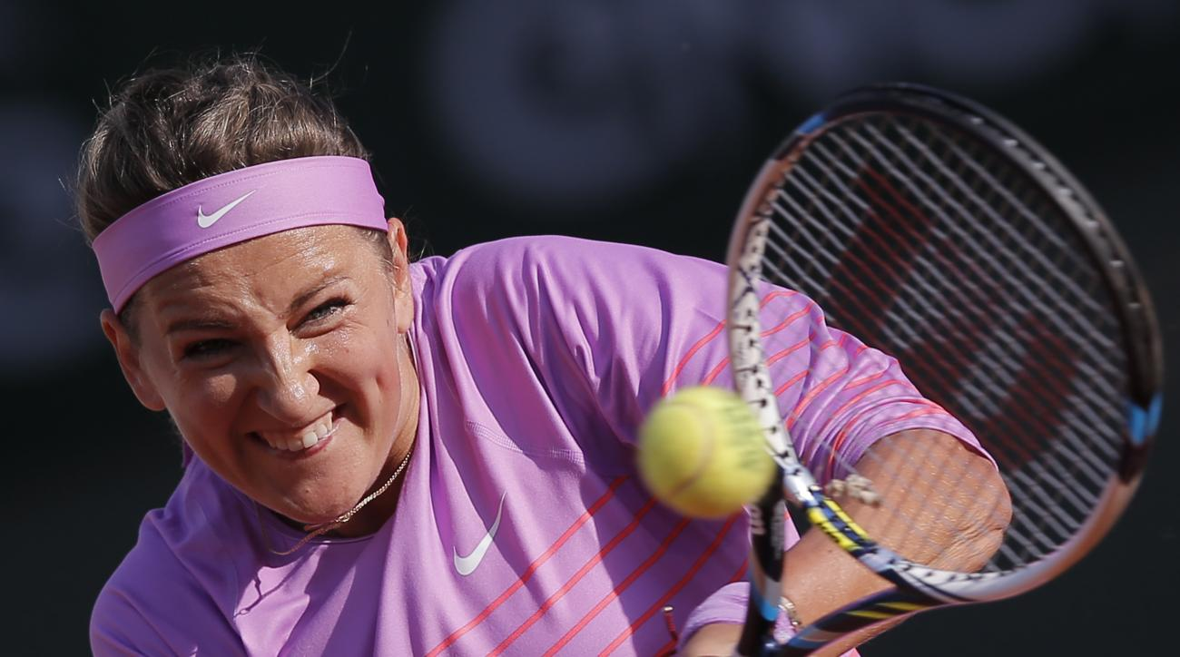 Victoria Azarenka of Belarus returns in the third round match of the French Open tennis tournament against Serena Williams of the U.S. at the Roland Garros stadium, in Paris, France, Saturday, May 30, 2015. (AP Photo/Christophe Ena)