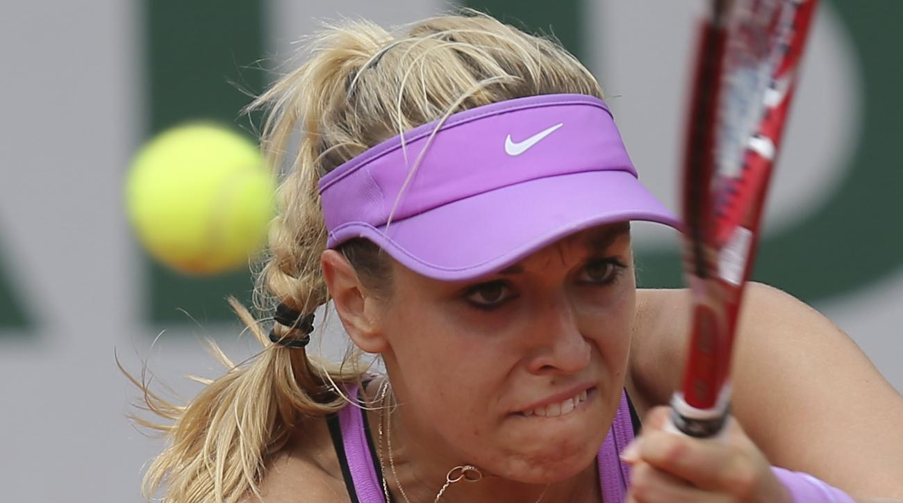 Germany's Sabine Lisicki returns in her third round match of the French Open tennis tournament against Lucie Safarova of the Czech Republic at the Roland Garros stadium, in Paris, France, Friday, May 29, 2015. (AP Photo/David Vincent)