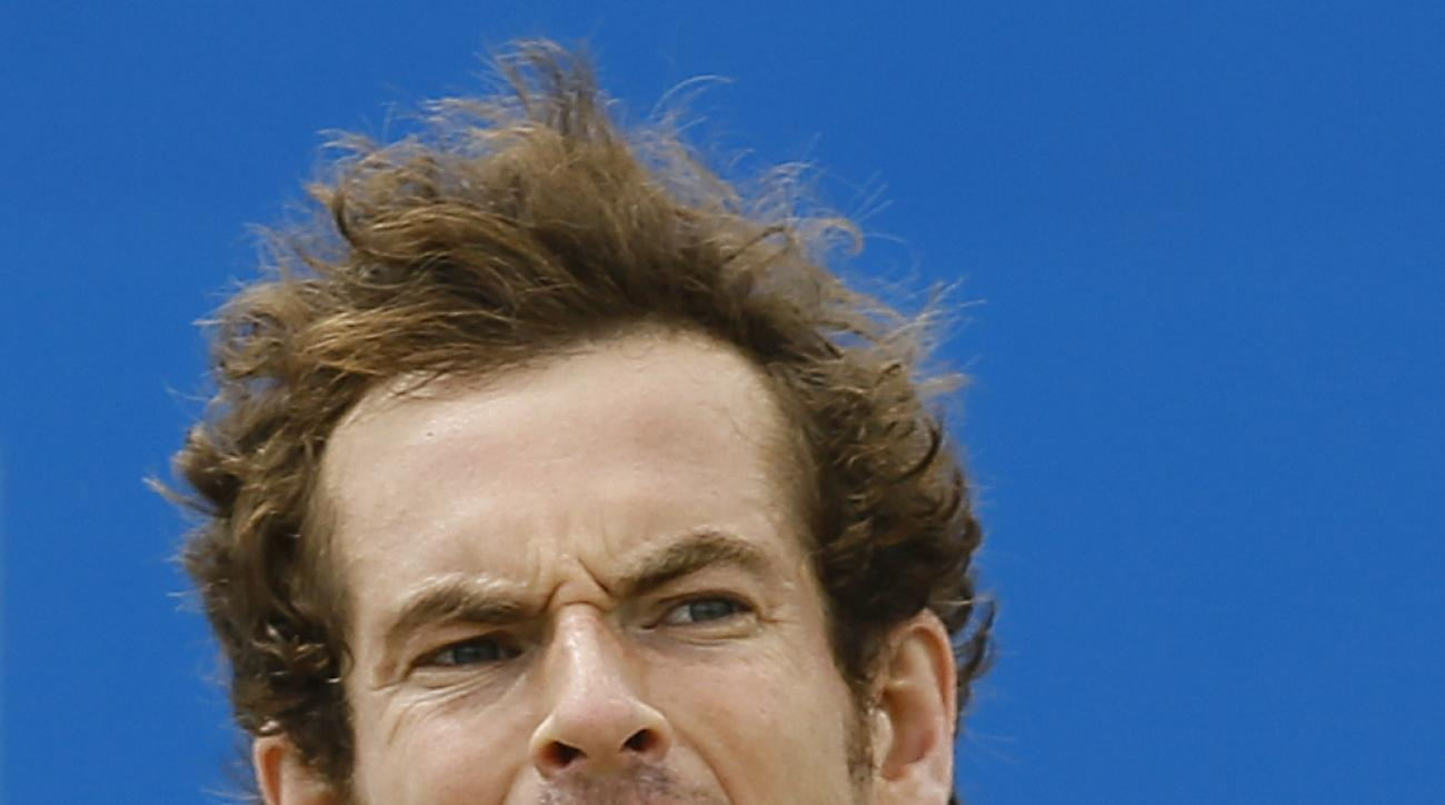 Andy Murray of Britain shouts after he plays a return to Viktor Troicki of Serbia during their semifinal tennis match at the Aegon Championships in London, Sunday, June 21, 2015. (AP Photo/Kirsty Wigglesworth)