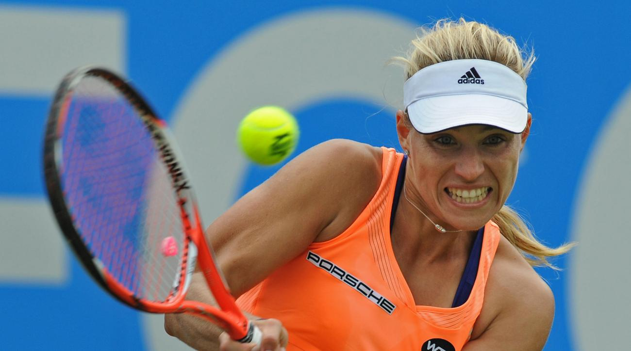 Germany's Angelique Kerber plays a shot during the Birmingham Classic Women's Singles Final against Czech's Karolina Pliskova at the Edgbaston Priory Club, Birmingham, England, Sunday, June 21, 2015. (AP Photo/Rui Vieira)