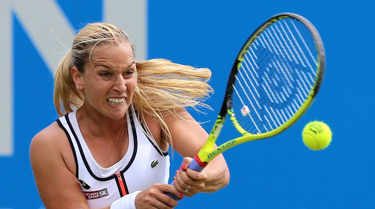 Slovakia's Dominika Cibulkova returns the ball to Britain's Harriet Dart during day three of the women's International tennis at Devonshire Park, Eastbourne, Monday June 22, 2015. (Gareth Fuller/PA via AP) UNITED KINGDOM OUT  NO SALES   NO ARCHIVE