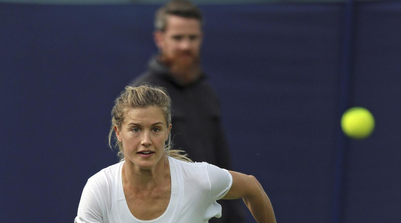 Canada's Eugenie Bouchard trains on the practice courts during day three of the women's International tennis at Devonshire Park, Eastbourne, Monday June 22, 2015. (Gareth Fuller/PA via AP) UNITED KINGDOM OUT  NO SALES   NO ARCHIVE