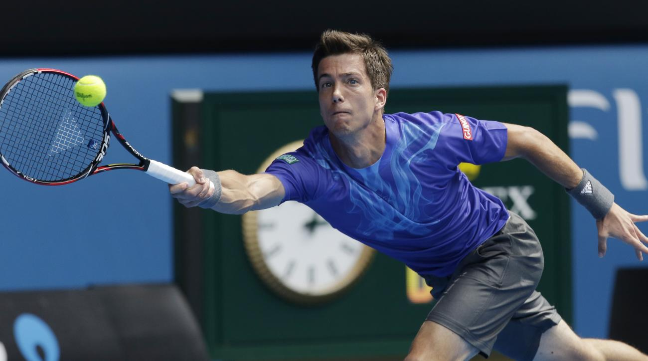 Slovenia's Aljaz Bedene makes backhand return to Novak Djokovic of Serbia during their first round match at the Australian Open tennis championship in Melbourne, Australia, Tuesday, Jan. 20, 2015. (AP Photo/Lee Jin-man)