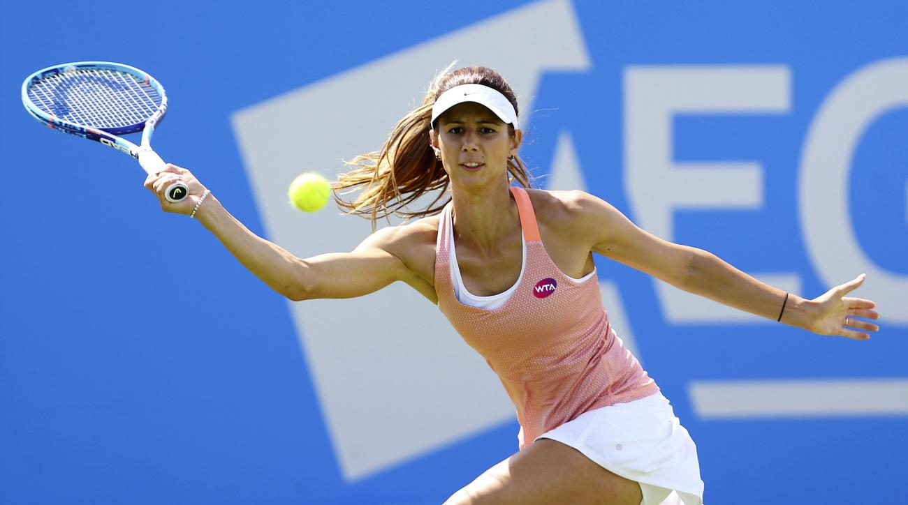 Bulgaria's Tsvetana Pironkova plays a return to Poland's Agnieszka Radwanska during day six of the women's international grass court tennis tournament in Eastbourne, England, Thursday, June 25, 2015. (Gareth Fuller/PA Wire via AP) UNITED KINGDOM OUT, NO S