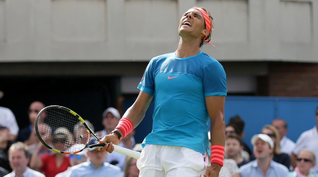 FILE - In this June 16, 2015, file photo, Spain's Rafael Nadal looks up after losing a point to Ukraine's Alexandr Dolgopolov during their men's singles tennis match at the Queen's tennis championships in London. (AP Photo/Tim Ireland, File)