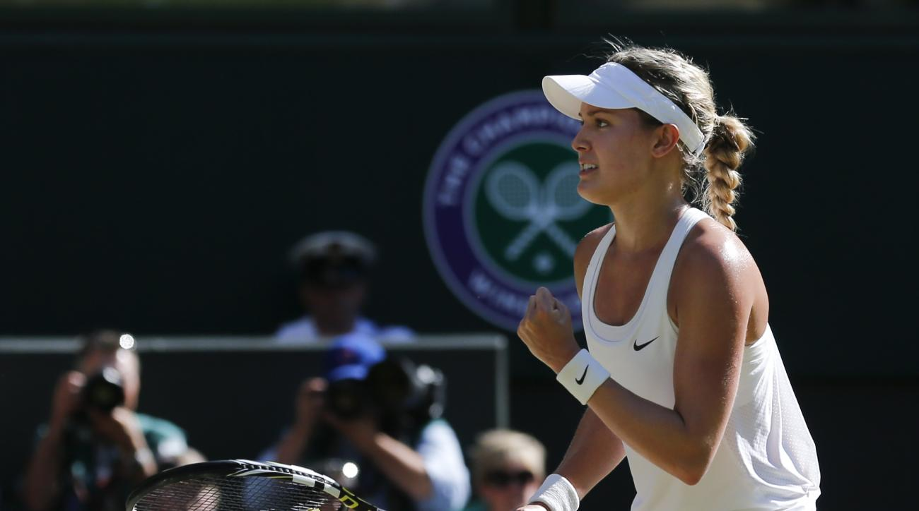FILE - In this July 3, 2014, file photo, Eugenie Bouchard, of Canada, turns to her family, friends and coaches as she defeats Simona Halep, of Romania, in their women's singles semifinal match at the All England Lawn Tennis Championships in Wimbledon, Lon
