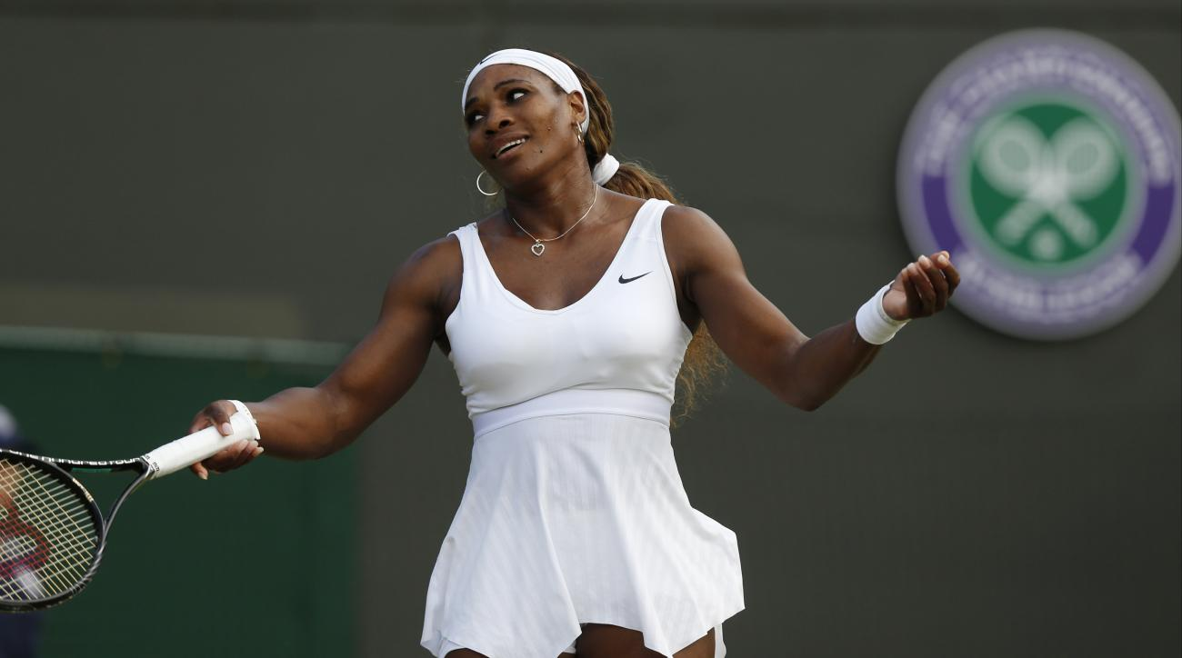 FILE - In this June 28, 2014, file photo, Serena Williams gestures during a women's singles match against Alize Cornet of France at the All England Lawn Tennis Championships in Wimbledon, London. A five-time champion and two-time runner-up at Wimbledon, S