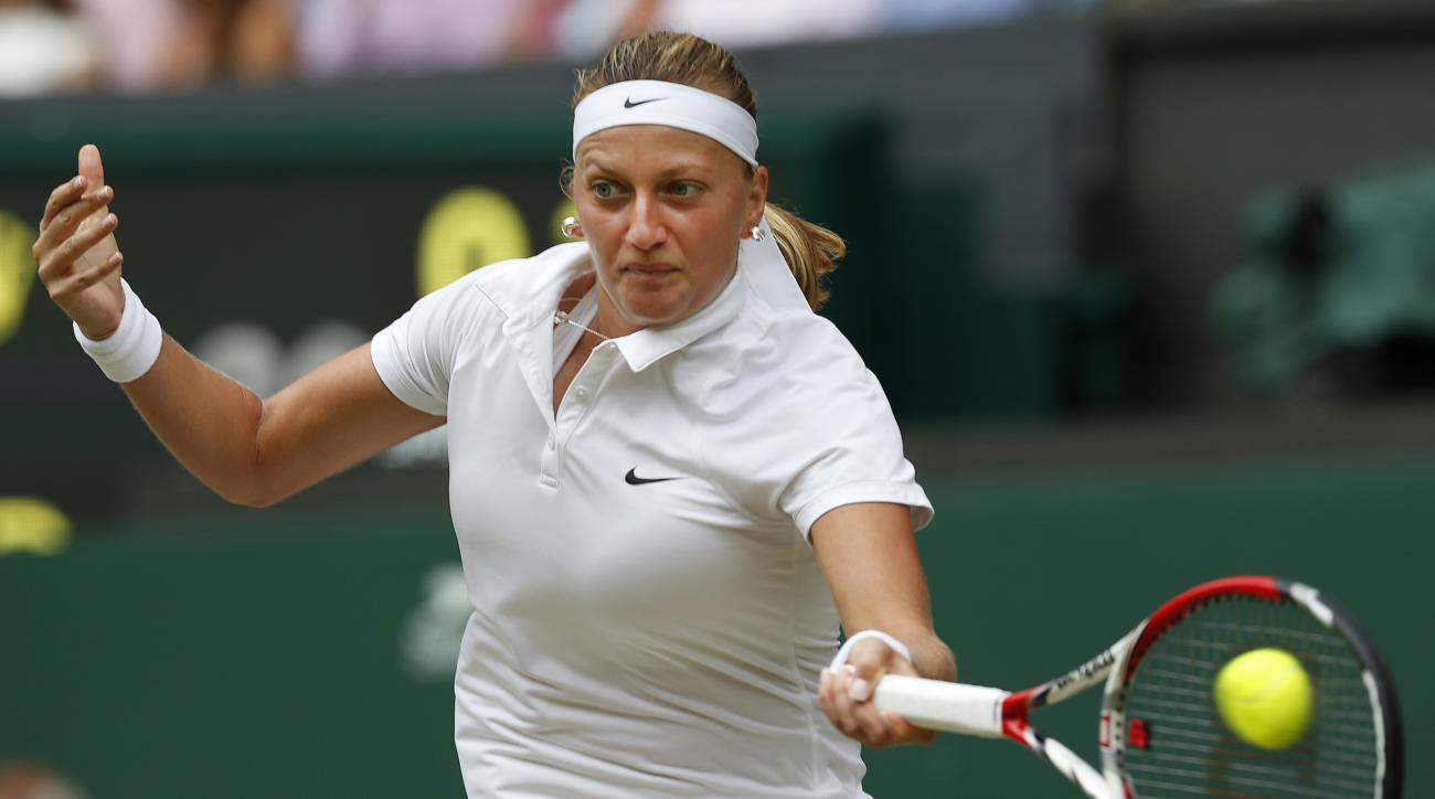 FILE - In this July 5, 2014, file photo, Petra Kvitova of the Czech Republic plays a return to Eugenie Bouchard of Canada during the women's singles final at the All England Lawn Tennis Championships in Wimbledon, London. Kvitove has made it to at least t