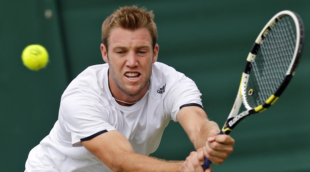 FILE - In this June 26, 2014, file photo, Jack Sock, of the United States, returns a shot to Milos Raonic, of Canada, during their men's singles match at the All England Lawn Tennis Championships at Wimbledon, London, England. Which of the younger set in