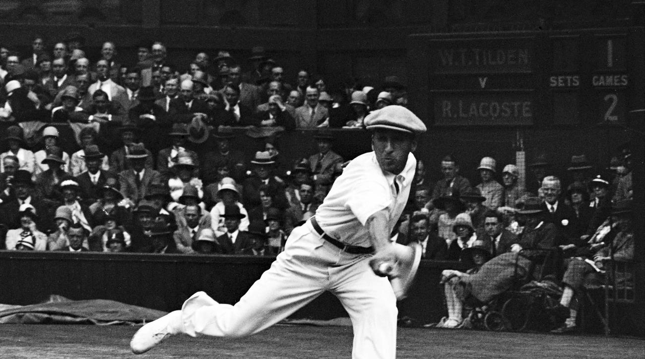 FILE - In this July 4, 1928 file photo, French tennis champion Rene Lacoste returns a shot,  during the men's singles semi-final match against American Bill Tilden, on the Centre Court at the All England Lawn Tennis Championships in Wimbledon, London. In