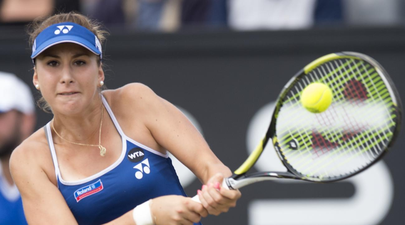 Belinda Bencic of Switzerland returns a shot in the women's final against Camila Giorgi of  Italy,  at the open grass court tournament in Rosmalen, central Netherlands, Sunday, June 14, 2015. (AP Photo/Ermindo Armino)