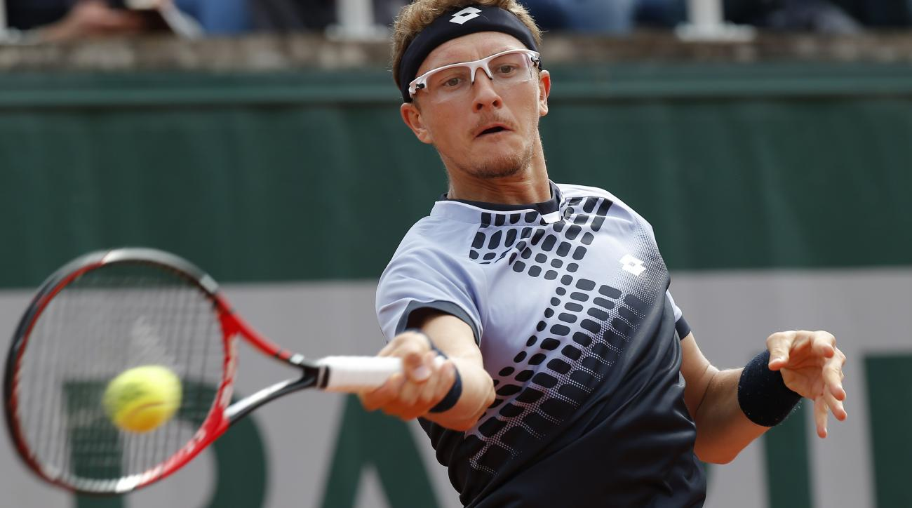 Uzbekistan's Denis Istomin returns the ball to Australia's Nick Kyrgios during their first round match of the French Open tennis tournament at the Roland Garros stadium, Monday, May 25, 2015 in Paris,  (AP Photo/Michel Euler)