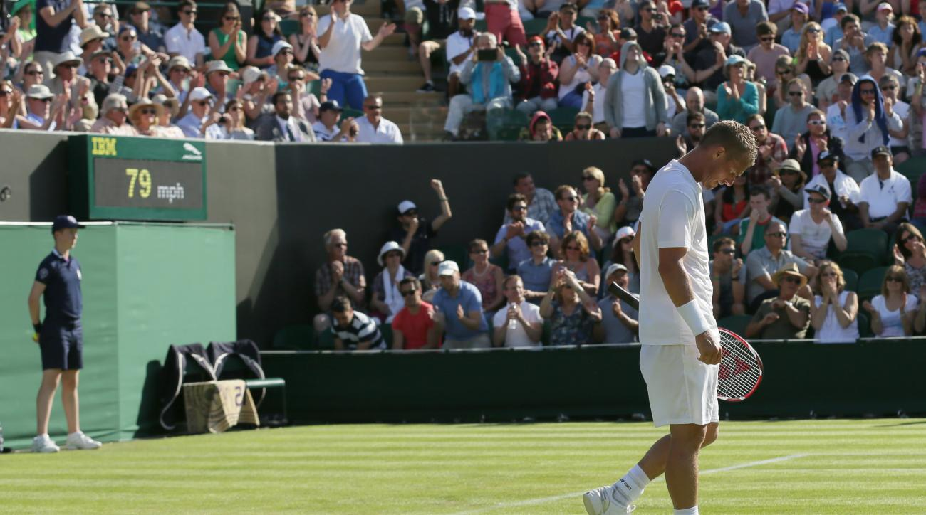 Lleyton Hewitt of Australia walks to the net after losing to Jarkko Nieminen of Finland in the men's singles first round match at the All England Lawn Tennis Championships in Wimbledon, London, Monday June 29, 2015. (AP Photo/Tim Ireland)