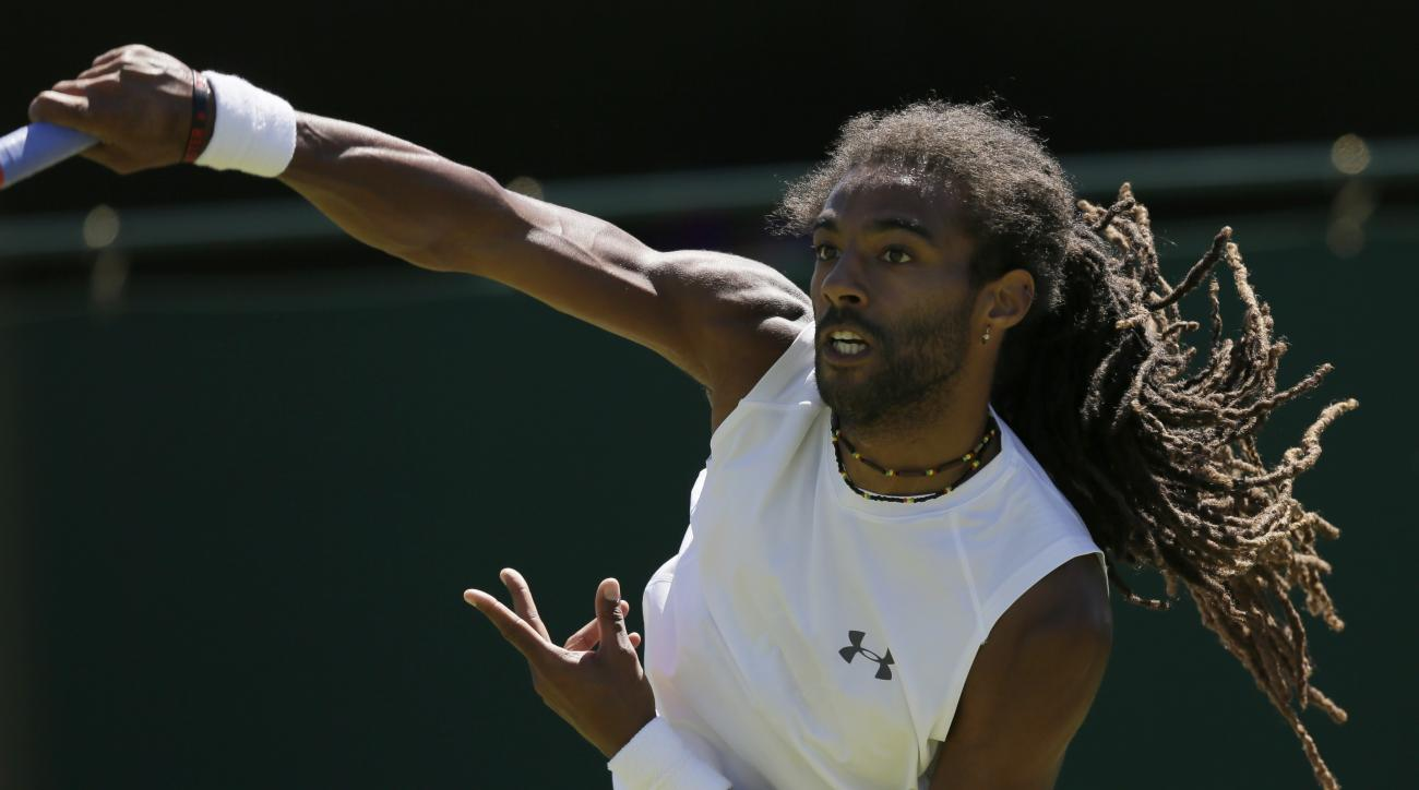 Dustin Brown of Germany serves to Yen-Hsun Lu of Taiwan during the singles first round match at the All England Lawn Tennis Championships in Wimbledon, London, Tuesday June 30, 2015. (AP Photo/Tim Ireland)