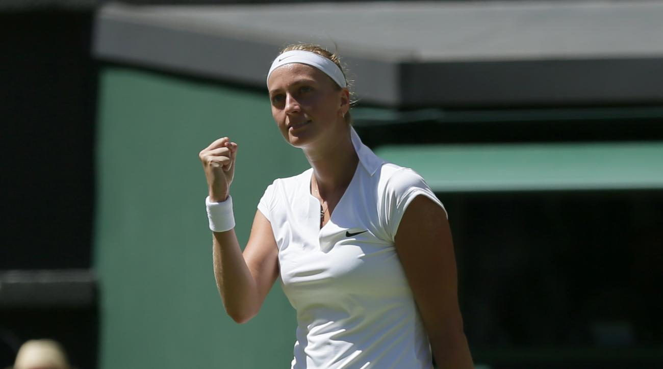 Petra Kvitova of the Czech Republic celebrates defeating Kiki Bertens of the Netherlands in their singles first round match at the All England Lawn Tennis Championships in Wimbledon, London, Tuesday June 30, 2015. Kvitova won the match 6-1, 6-0. (AP Photo