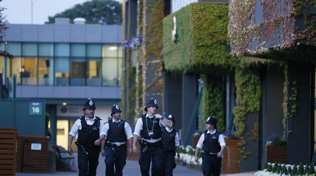 Police officers attend an incident outside Centre Court, at the All England Lawn Tennis Championships in Wimbledon, London, Wednesday July 1, 2015.(AP Photo/Kirsty Wigglesworth)