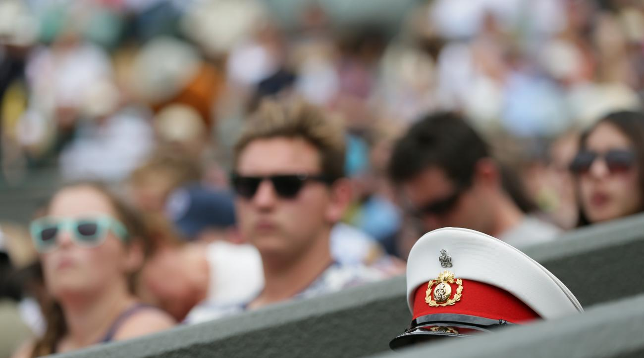 The top of a military steward's hat in view, at the All England Lawn Tennis Championships in Wimbledon, London, Monday July 6, 2015. (AP Photo/Tim Ireland)