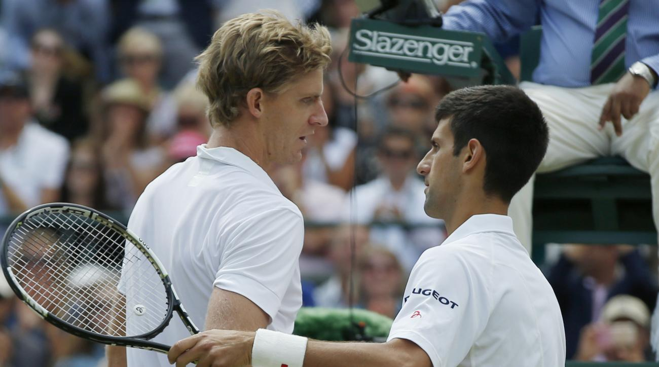 Novak Djokovic of Serbia, right, shakes hands at the net with Kevin Anderson of South Africa, after winning their singles match,  at the All England Lawn Tennis Championships in Wimbledon, London, Tuesday July 7, 2015.  Djokovic won 6-7, 6-7, 6-1, 6-4, 7-