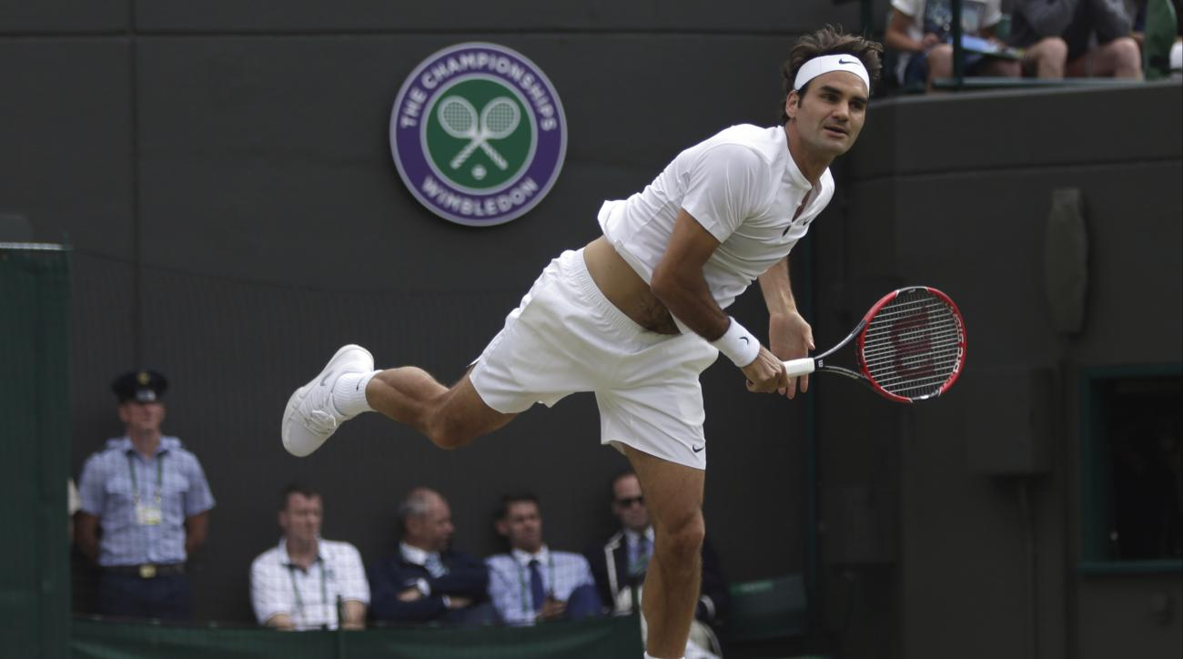 Roger Federer of Switzerland serves to Gilles Simon of France during their singles match at the All England Lawn Tennis Championships in Wimbledon, London, Wednesday July 8, 2015. (AP Photo/Pavel Golovkin)