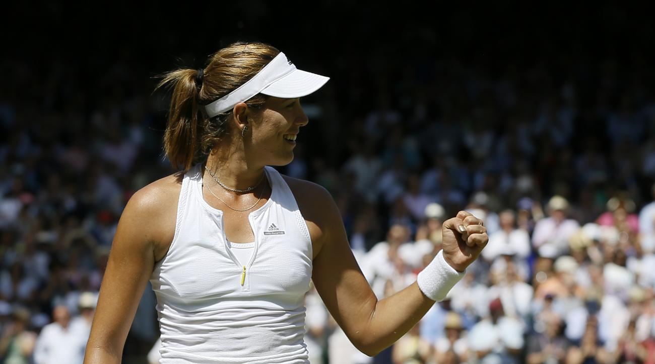 Garbine Muguruza of Spain celebrates winning a point against Agnieszka Radwanska of Poland during their women's singles semifinal match at the All England Lawn Tennis Championships in Wimbledon, London, Thursday July 9, 2015. (AP Photo/Kirsty Wigglesworth