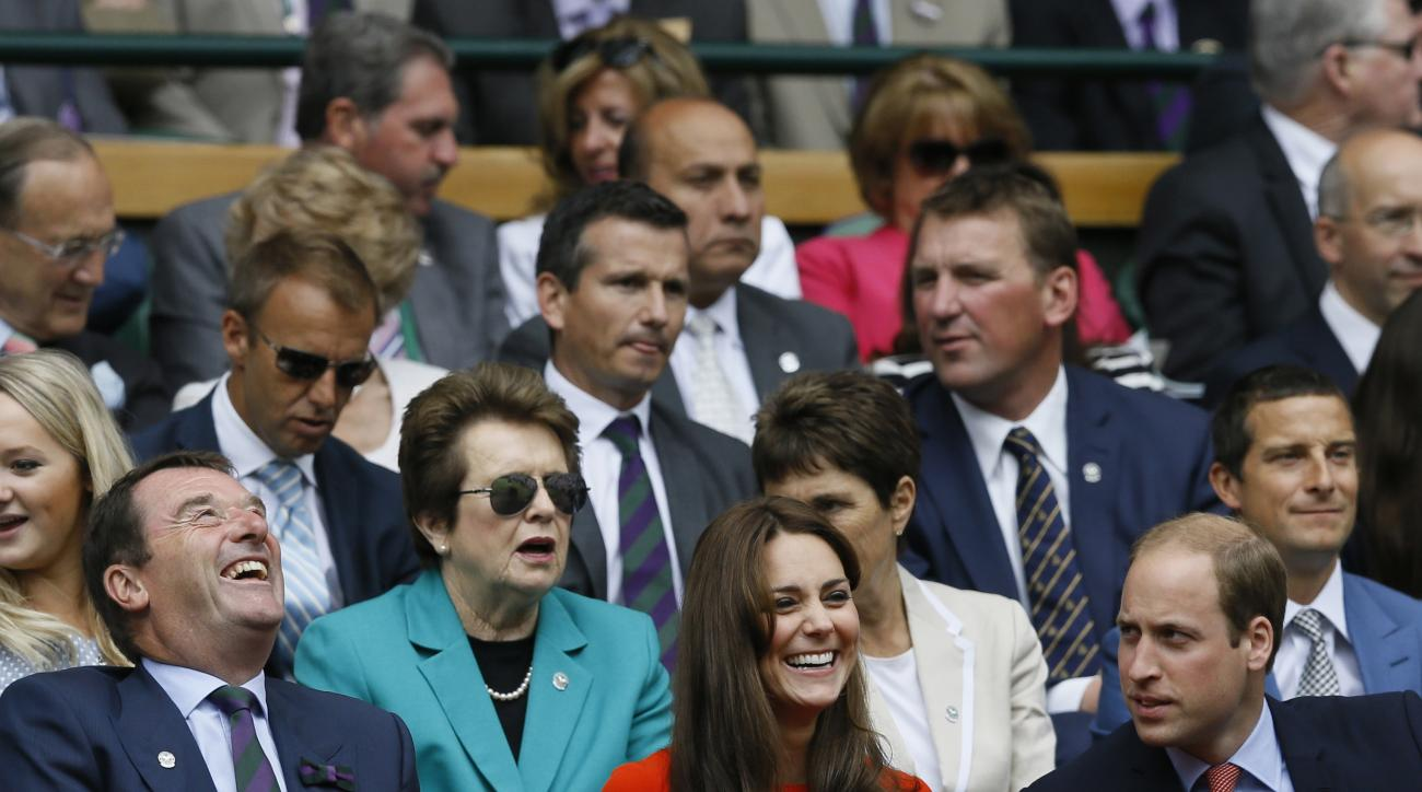FILE - In this July 8, 2015 file photo, Britain's Prince William, the Duke of Cambridge right, and Kate, the Duchess of Cambridge sit with the All England Lawn Tennis Club Chairman Philip Brook in the Royal Box on Centre Court, with former Wimbledon Champ