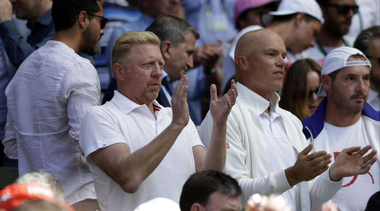 Former Wimbledon champion Boris Becker, the coach of Novak Djokovic of Serbia applauds, during the men's singles semifinal match between Djokovic and Richard Gasquet of France,  at the All England Lawn Tennis Championships in Wimbledon, London, Friday Jul