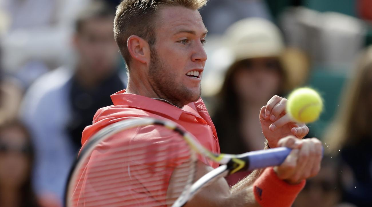 Jack Sock of the U.S. returns in the fourth round match of the French Open tennis tournament against Spain's Rafael Nadal at the Roland Garros stadium, in Paris, France, Monday, June 1, 2015. (AP Photo/Thibault Camus)