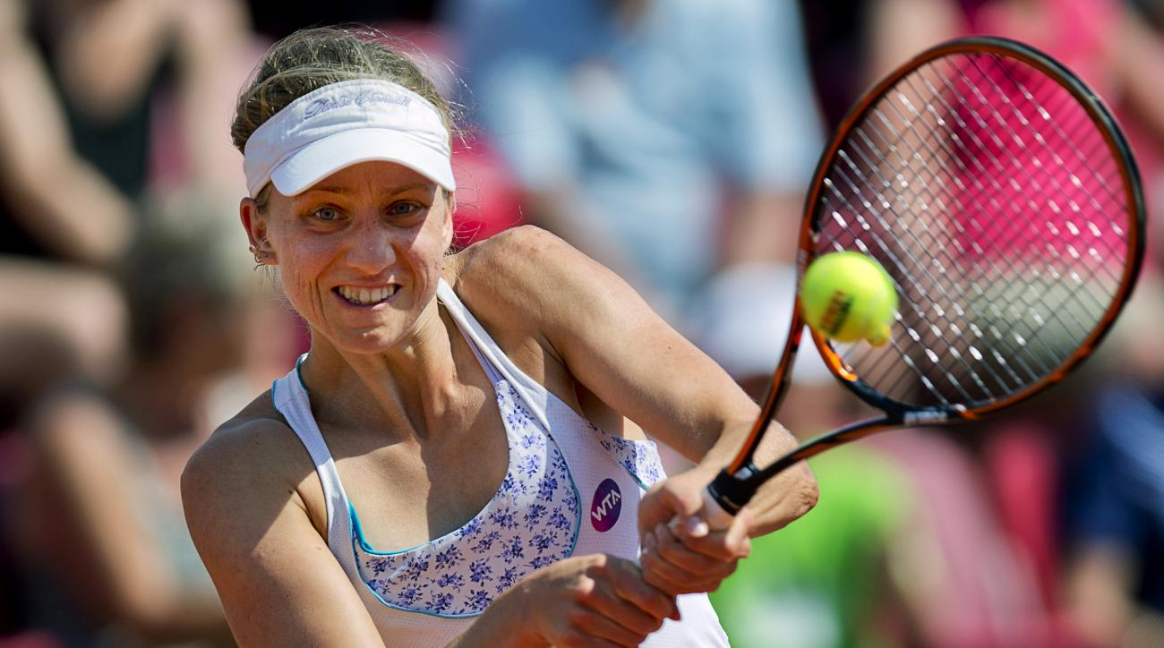 Mona Barthel of Germany returns a ball to Laura Arruabarrena of Spain during their semifinal Swedish Open match in Bastad, Sweden, on July 18, 2015. (Adam Ihse/TT via AP) SWEDEN OUT