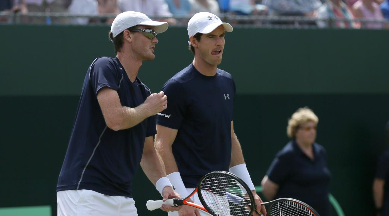 Britain's Andy Murray, right, and Jamie Murray during their doubles match against France's Jo-Wilfried Tsonga and Nicolas Mahut during the quarterfinal match of the Davis Cup at the Queen's Club in London, Saturday July 18, 2015. (AP Photo/Tim Ireland)
