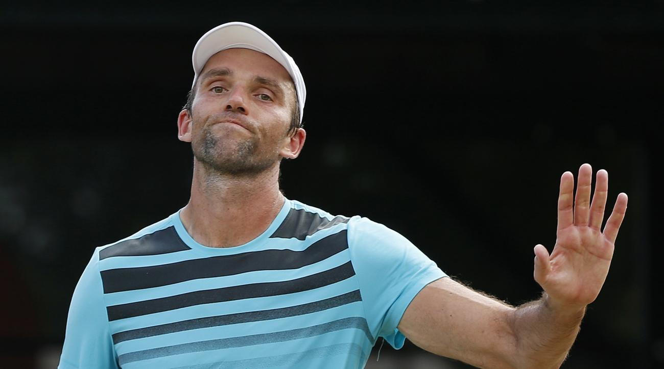 Ivo Karlovic, of Croatia, reacts after losing a point in the Tennis Hall of Fame Championship final against Rajeev Ram in Newport, R.I., Sunday, July 19, 2015. (AP Photo/Michael Dwyer)