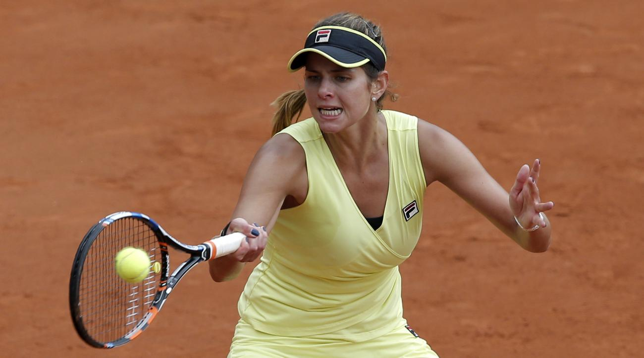 Germany's Julia Goerges returns the ball to Denmark's Caroline Wozniacki during their second round match of the French Open tennis tournament at the Roland Garros stadium, Thursday, May 28, 2015 in Paris. Georges won 6-4, 7-6.  (AP Photo/Christophe Ena)