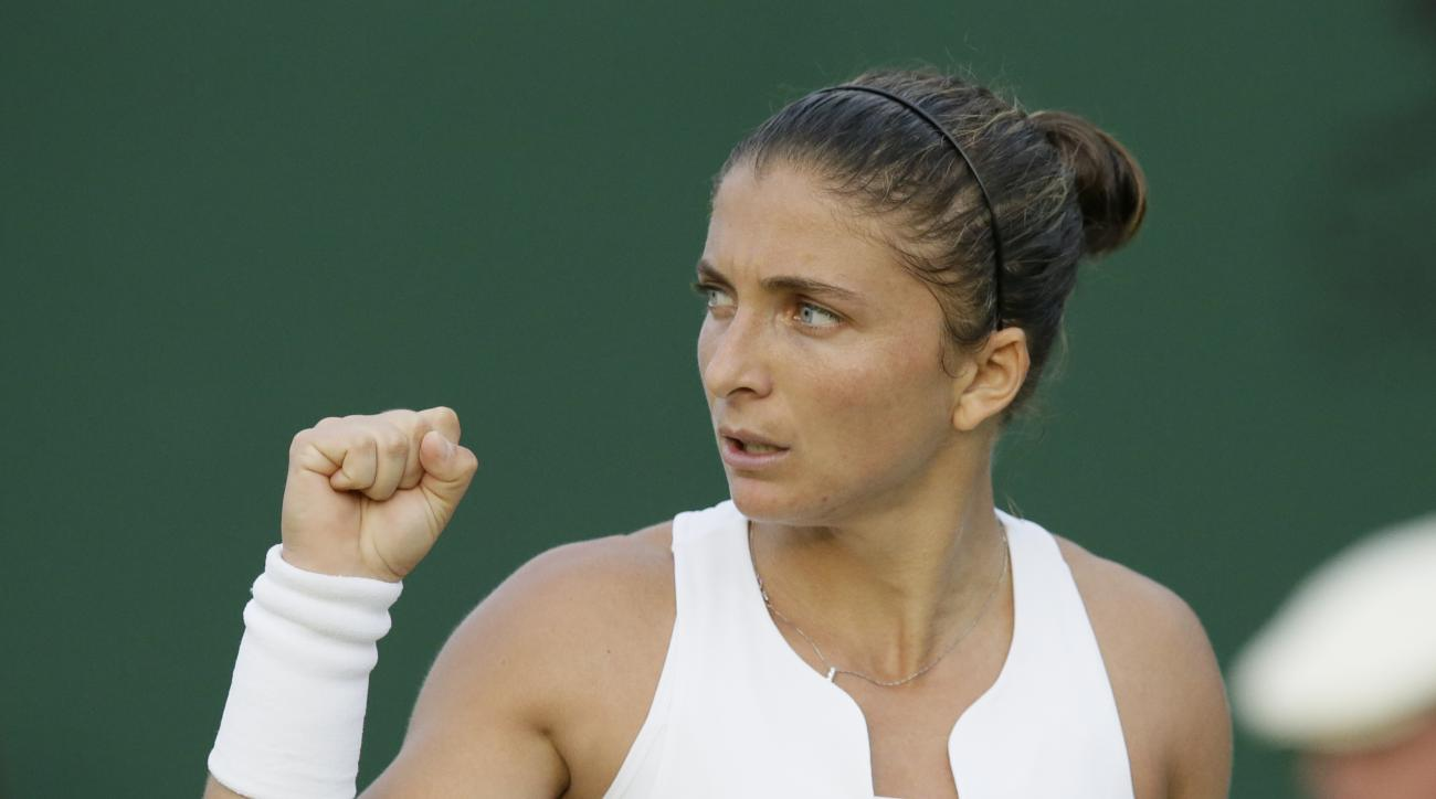 Sara Errani of Italy celebrates a point against Aleksandra Krunic of Serbia during their singles match at the All England Lawn Tennis Championships in Wimbledon, London, Wednesday July 1, 2015. (AP Photo/Tim Ireland)