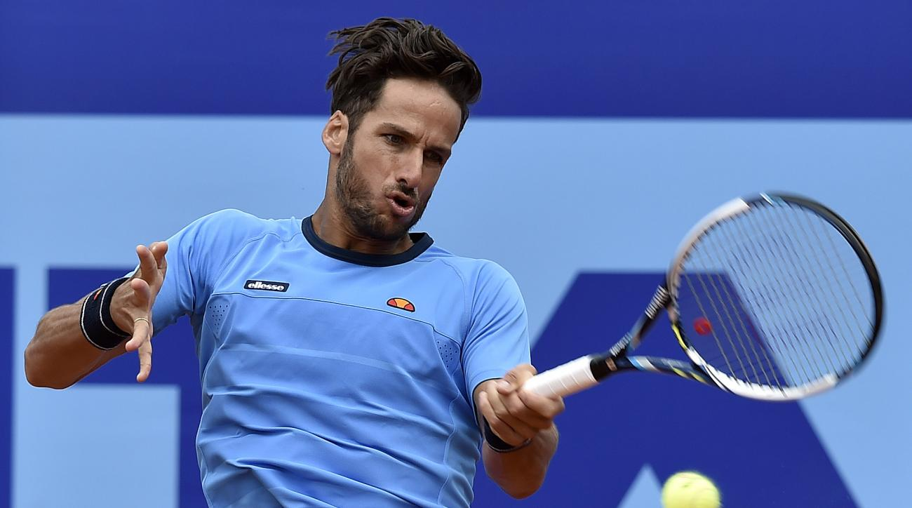 Feliciano Lopez of Spain returns a  shot to Dominic Thiem of Austria during their semifinal match  at the Suisse Open tennis tournament in Gstaad, Switzerland, Saturday, Aug.  1, 2015. (Peter Schneider/Keystone via AP)
