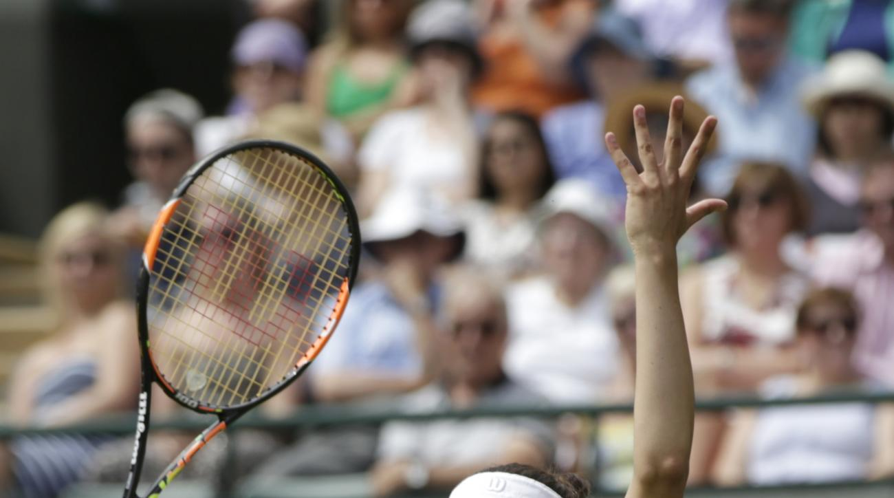 Margarita Gasparyan of Russia gestures during the women's singles first round match against Serena Williams of the United States at the All England Lawn Tennis Championships in Wimbledon, London, Monday June 29, 2015. (AP Photo/Pavel Golovkin)