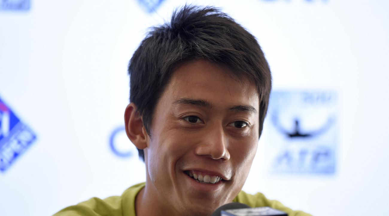 Kei Nishikori, of Japan, speaks at a press conference at the Citi Open tennis tournament, Monday, Aug. 3, 2015, in Washington. (AP Photo/Nick Wass)