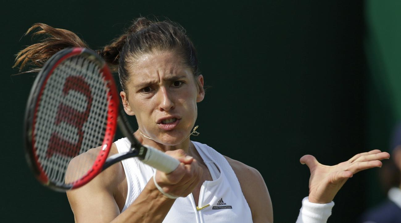 Andrea Petkovic of Germany returns to Zarina Diyas of Kazakhstan during their singles match at the All England Lawn Tennis Championships in Wimbledon, London, Friday July 3, 2015. (AP Photo/Alastair Grant)