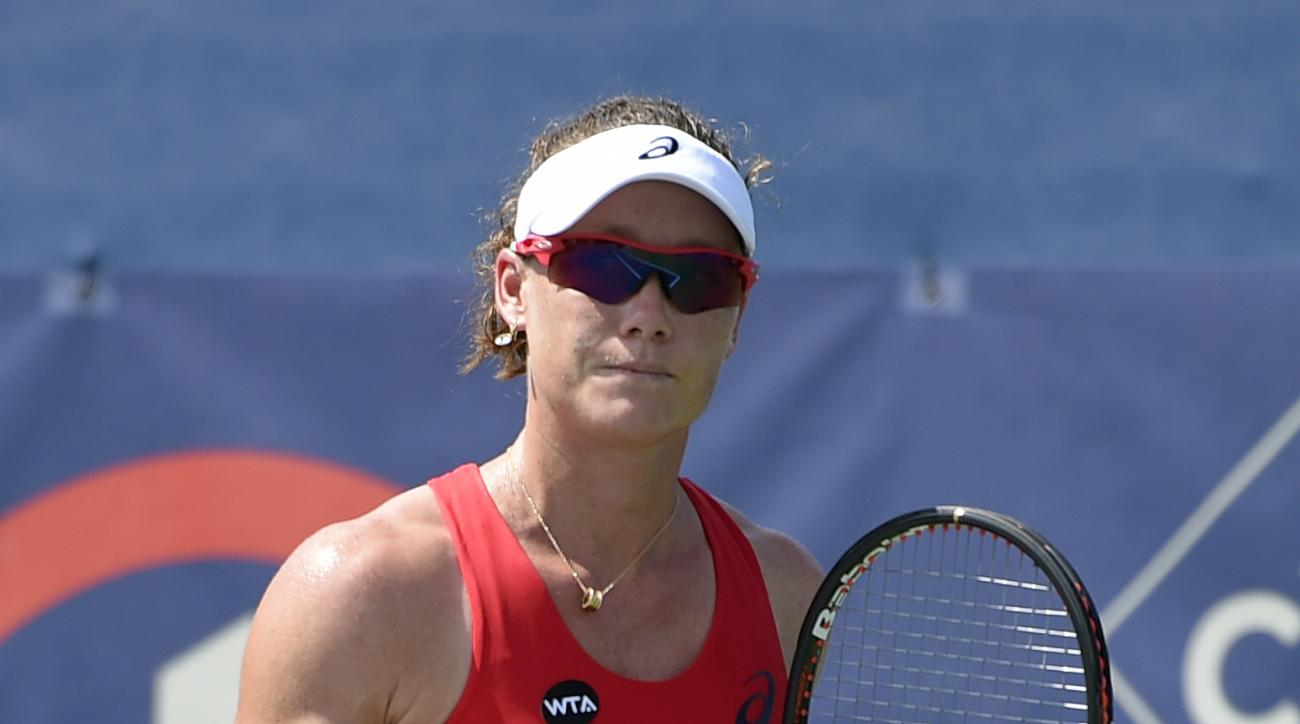 Samantha Stosur, of Australia, reacts during her match against Kristina Mladenovic, of France, at the Citi Open tennis tournament, Tuesday, Aug. 4, 2015, in Washington. (AP Photo/Nick Wass)