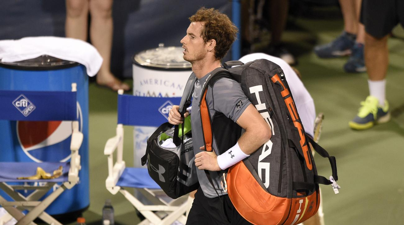Andy Murray, of Britain, leaves the court after he lost to Teymuraz Gabashvili, of Russia, 6-4, 4-6, 7-6 (4) at the Citi Open tennis tournament, Wednesday, Aug. 5, 2015, in Washington. (AP Photo/Nick Wass)