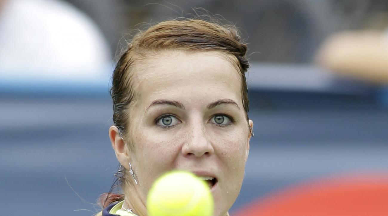 Anastasia Pavlyuchenkova, of Russia, returns the ball to Belinda Bencic, of Switzerland, during the Citi Open tennis tournament, Thursday, August 6, 2015, in Washington. Pavlyuchenkova won 6-2, 6-4. (AP Photo/Luis M. Alvarez)