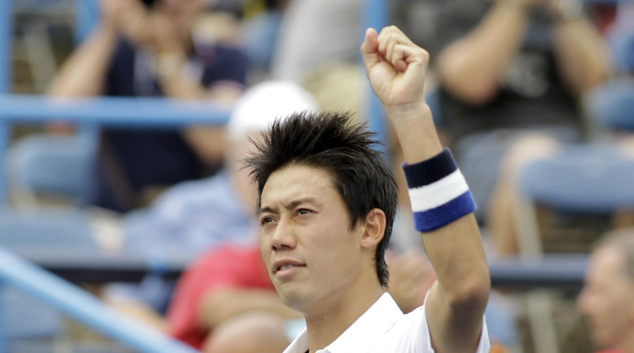 Kei Nishikori, of Japan, acknowledges the crowd after defeating Sam Groth, of Australia,  6-4, 6-4, during a quarterfinal match at the Citi Open tennis tournament, Friday Aug. 7, 2015, in Washington. (AP Photo/Luis M. Alvarez)