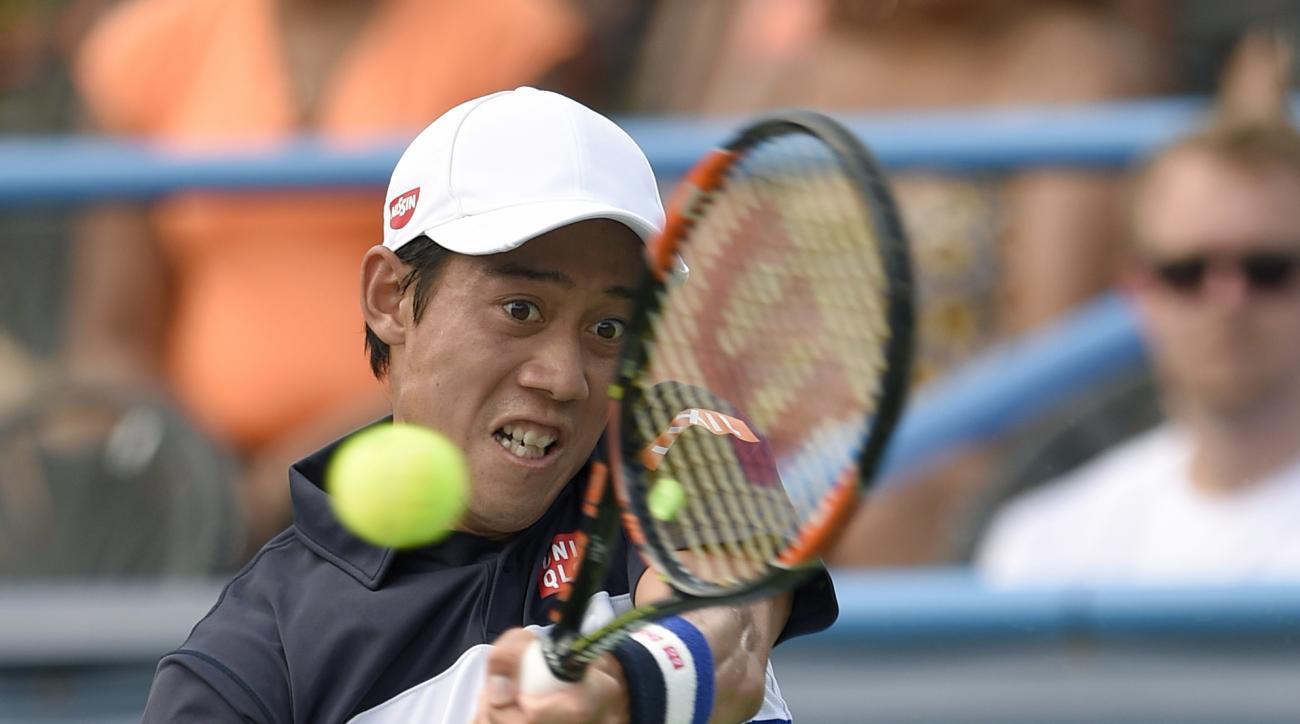 Kei Nishikori, of Japan, returns the ball against Marin Cilic, of Croatia, at the Citi Open tennis tournament, Saturday, Aug. 8, 2015, in Washington. (AP Photo/Nick Wass)