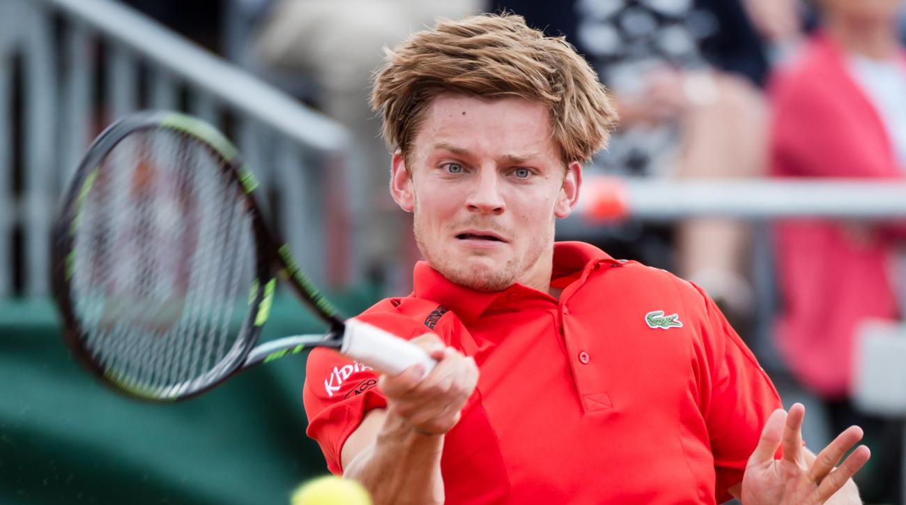 Belgium's David Goffin returns the ball to Canada's Filip Peliwo during the Davis Cup World Group Quarterfinals match between Belgium and Canada, in Middelkerke, Belgium, on Friday July 17 2015. (AP Photo/Geert Vanden Wijngaert)