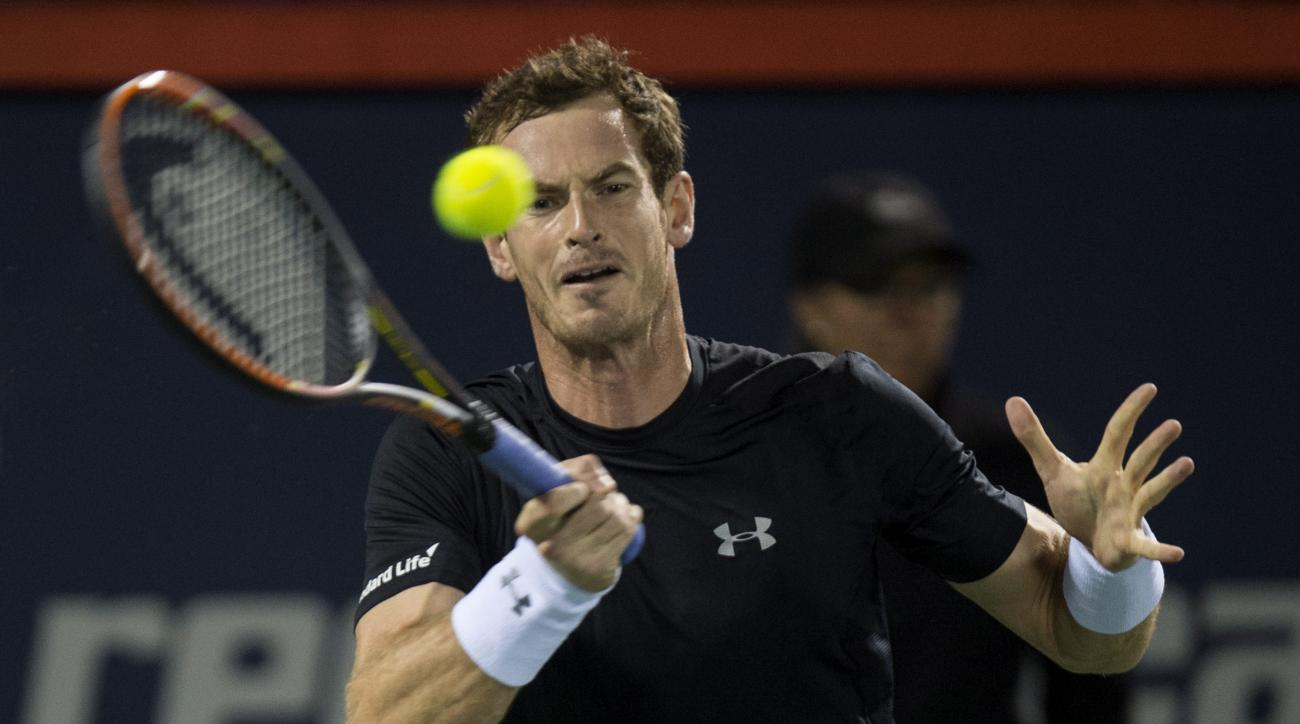 Andy Murray, of Britain, returns to Tommy Robredo, of Spain, at the Rogers Cup tennis tournament Tuesday, Aug. 11, 2015, in Montreal. (Paul Chiasson/The Canadian Press via AP)