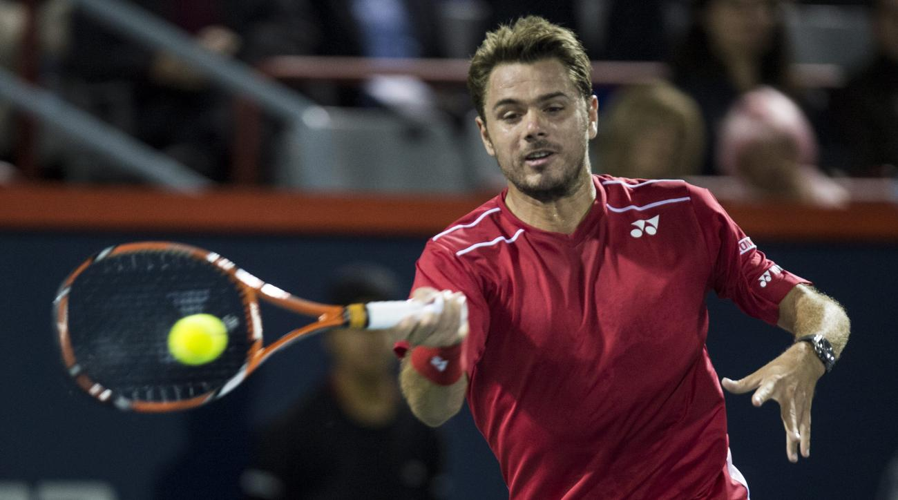 Stan Wawrinka, of Switzerland, returns to Nick Kyrgios, of Australia, at the Rogers Cup tennis tournament Wednesday, Aug. 12, 2015, in Montreal. (Paul Chiasson/The Canadian Press via AP)