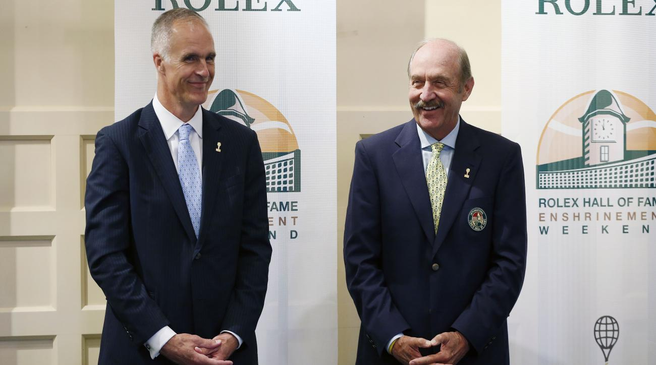 FILE - In this July 18, 2015, file photo, International Tennis Hall of Fame CEO Todd Martin, left, and president Stan Smith stand together before a news conference introducing the 2015 inductees to International Tennis Hall of Fame in Newport, R.I. Martin