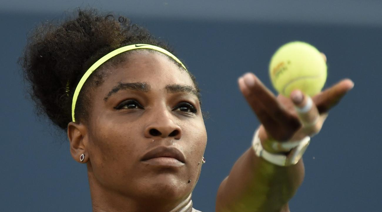 Serena Williams, of the United States, serves to Belinda Bencic, of Switzerland, during the Rogers Cup semifinal tennis tournament, Saturday, Aug. 15, 2015 in Toronto. (Frank Gunn/The Canadian Press via AP) MANDATORY CREDIT