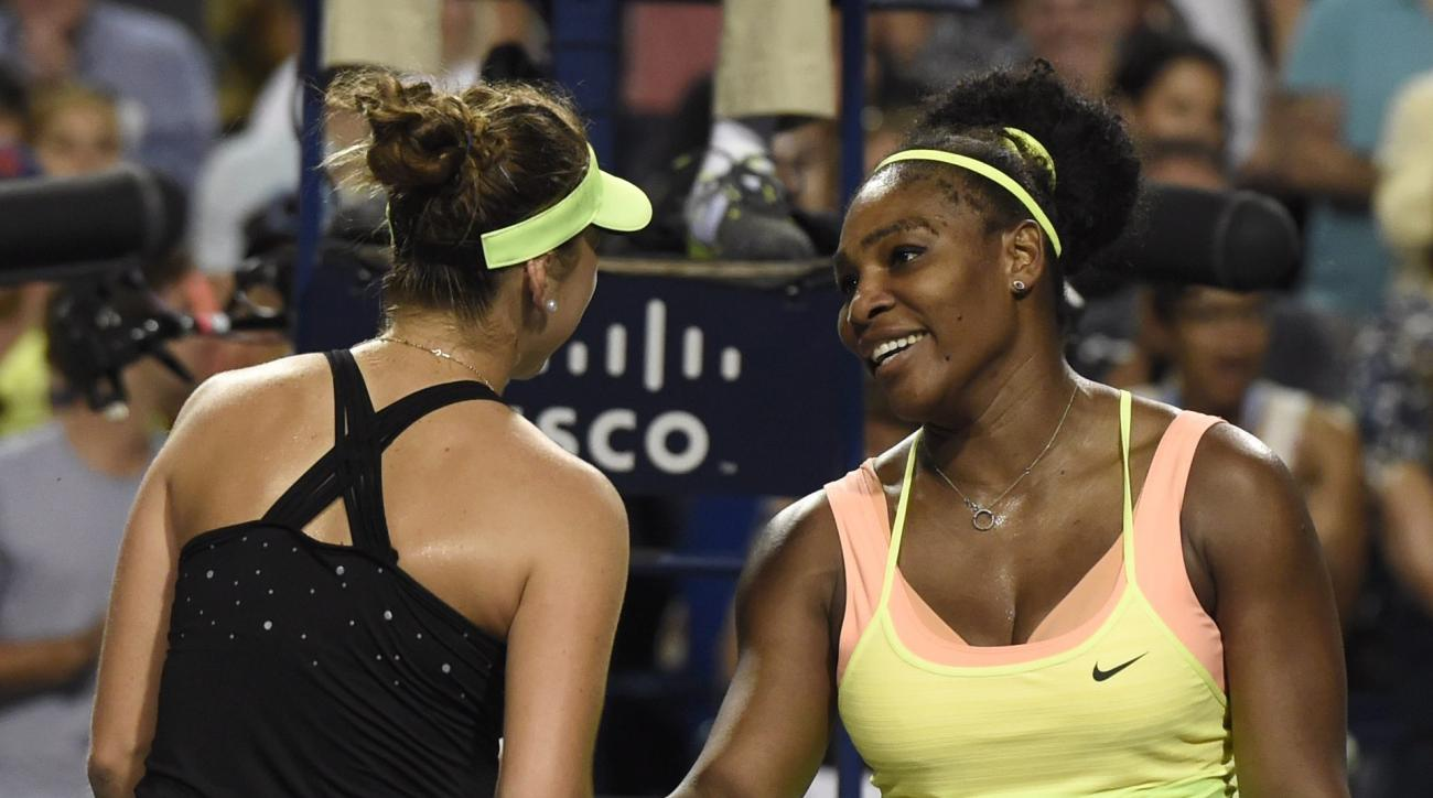 Belinda Bencic, right, of Switzerland, is congratulated by Serena Williams after she defeated Williams, of the United States, during the Rogers Cup semifinal tennis tournament, Saturday, Aug. 15, 2015 in Toronto. (Frank Gunn/The Canadian Press via AP) MAN